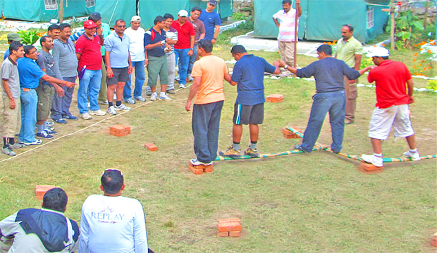 corporate group doing a task at the camps during a workshop